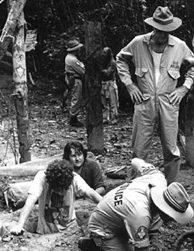 Bryan Law, centre, partly obscured, awaits the back-hoe at the Daintree Blockade 1984?  1985?